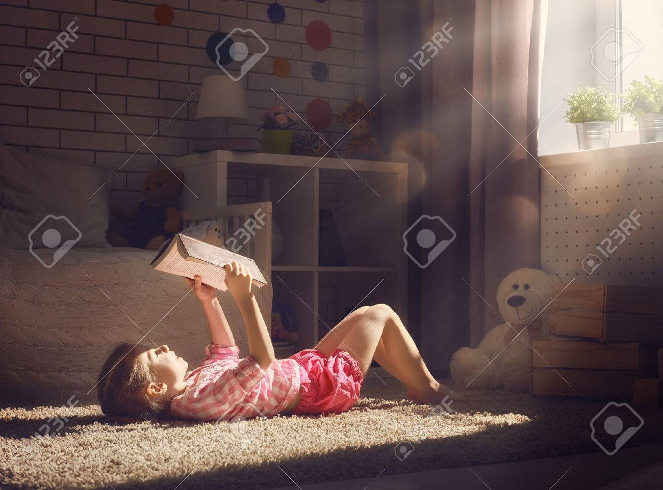 Cute little child girl reading a book. - 56780887