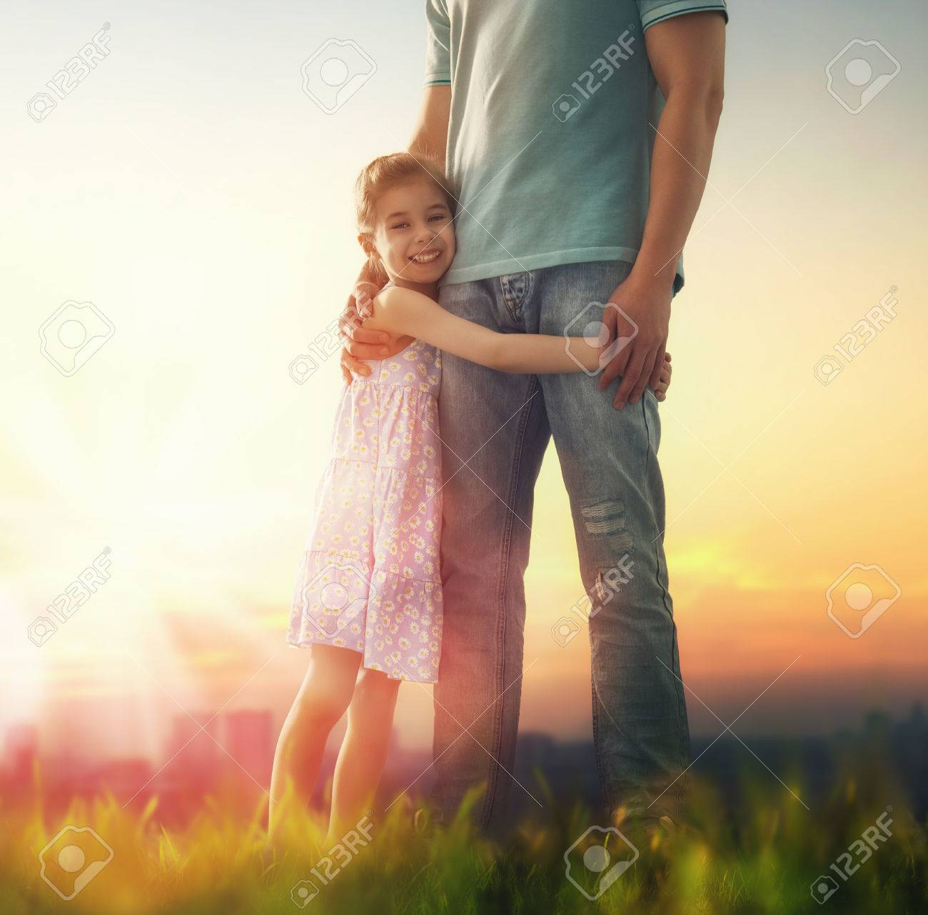a9e6834e Happy loving family. Father and his daughter child girl playing and hugging  outdoors. Cute