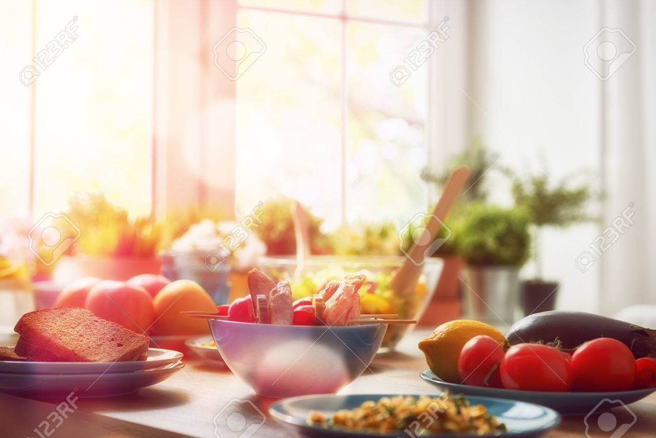 balanced diet, cooking, culinary and food concept. food for a family dinner on a wooden table in the dining room. - 59182737