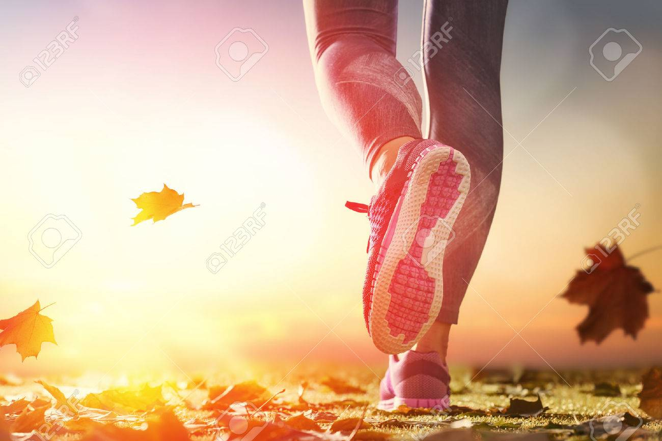 athlete's foots close-up on autumn walk in nature outdoors. healthy lifestyle and sport concepts. - 62741706