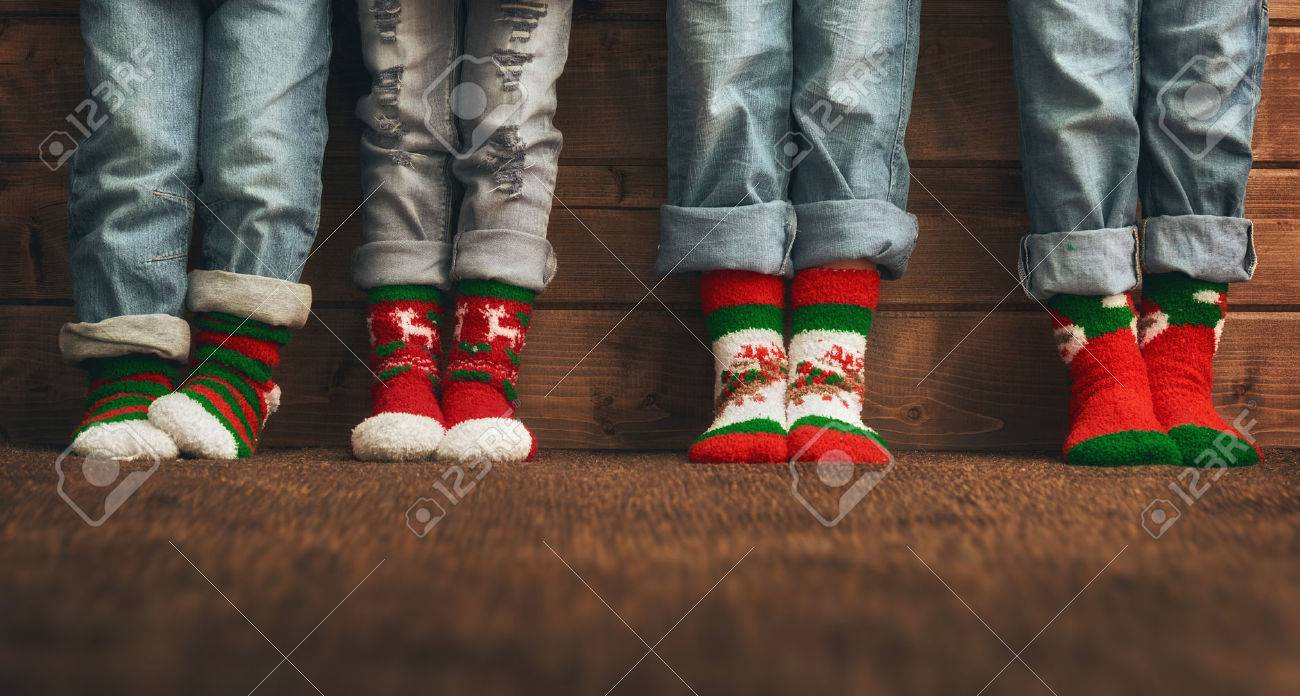 Colorful Christmas Background For Kids.Merry Christmas And Happy Holidays Group Of Four Kids On Wooden