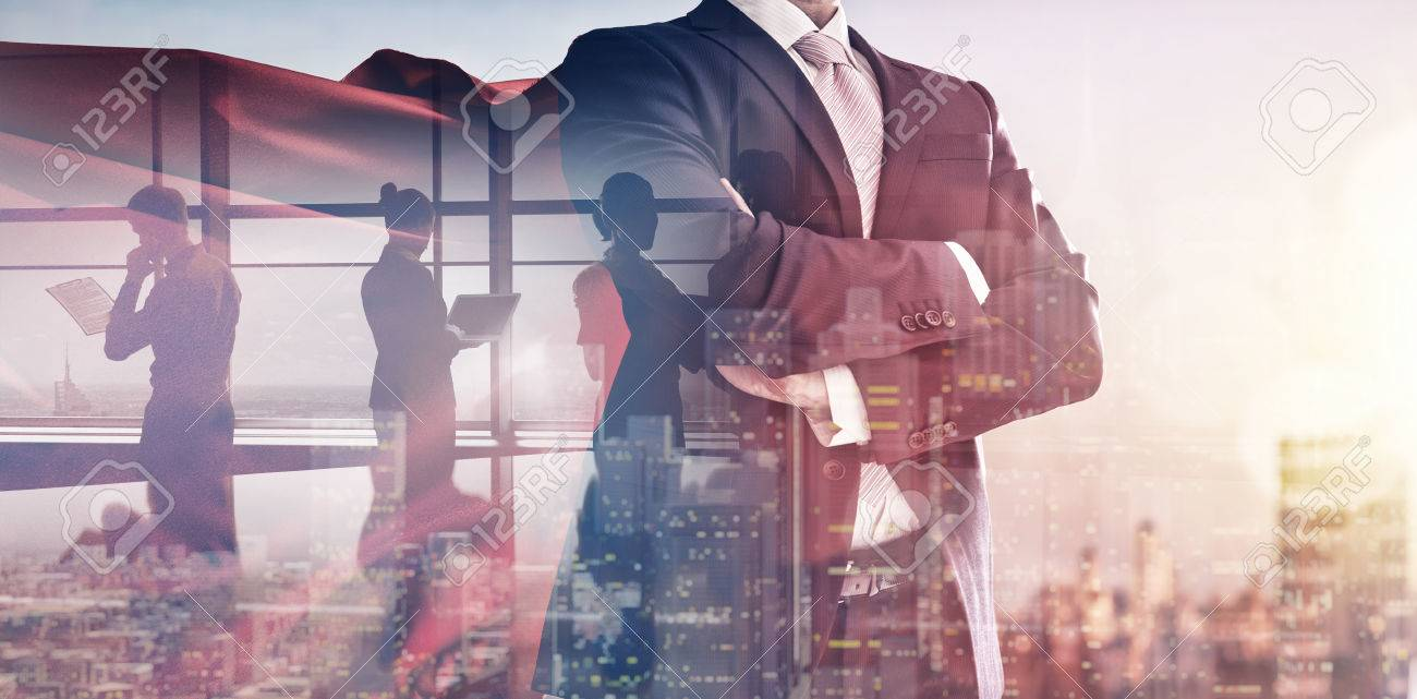 superhero businessman looking at city skyline at sunset. the concept of success, leadership and victory in business. - 71541751