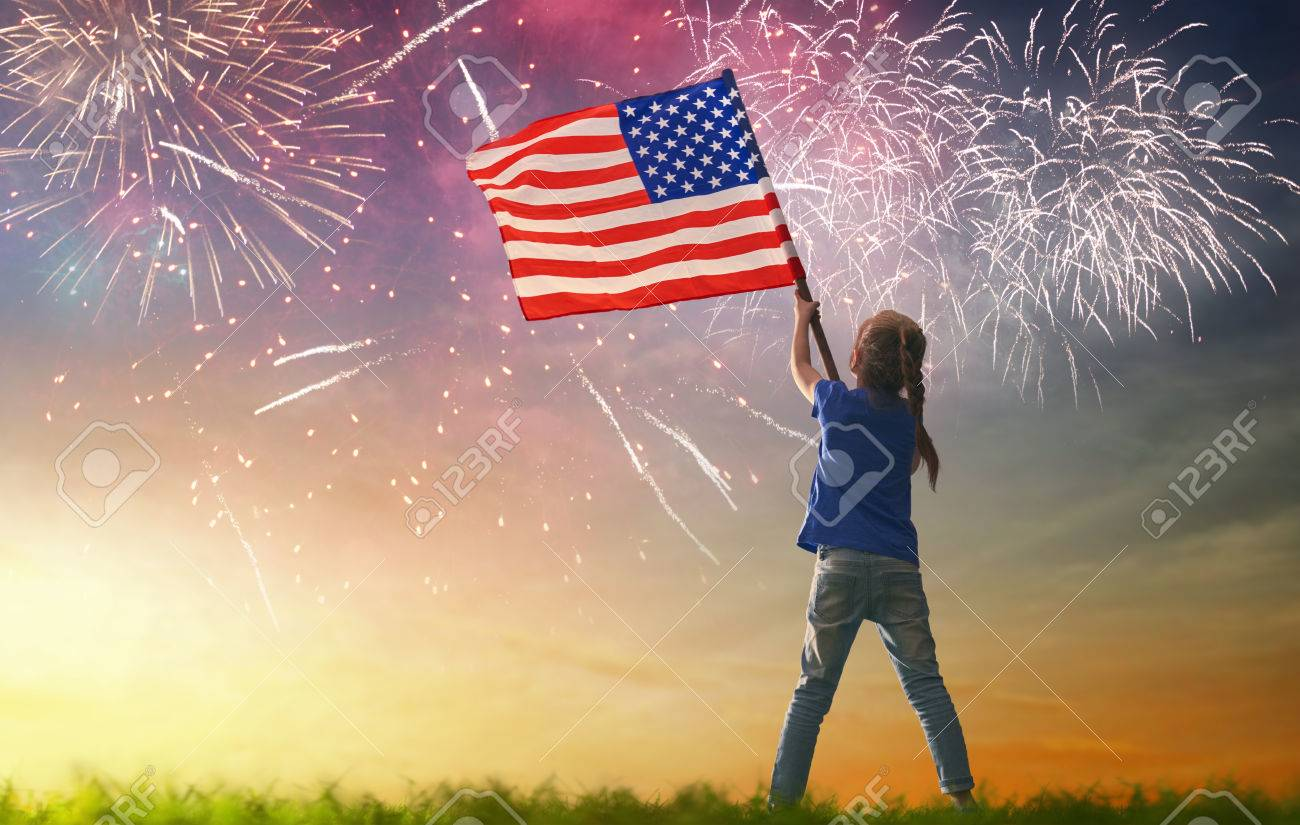 Patriotic holiday. Happy kid, cute little child girl with American flag. USA celebrate 4th of July. - 78504498