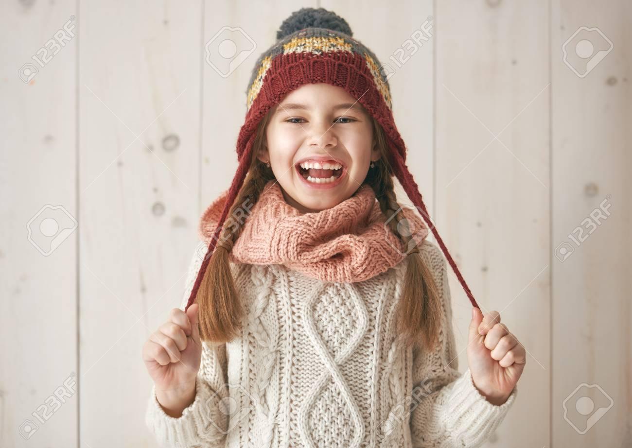 5272b74ae Winter Portrait Of Happy Little Girl Wearing Knitted Hat