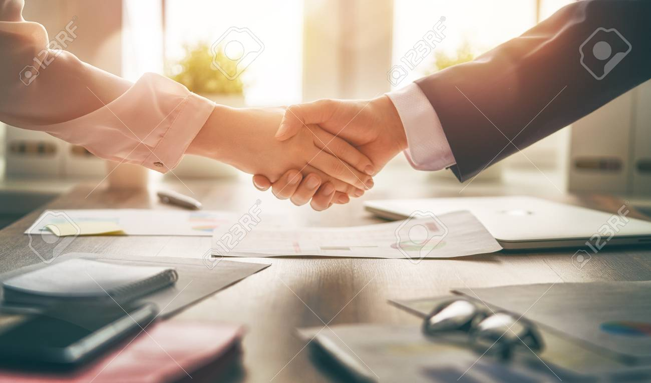 Man and woman are shaking hands in office. Collaborative teamwork. - 94463233