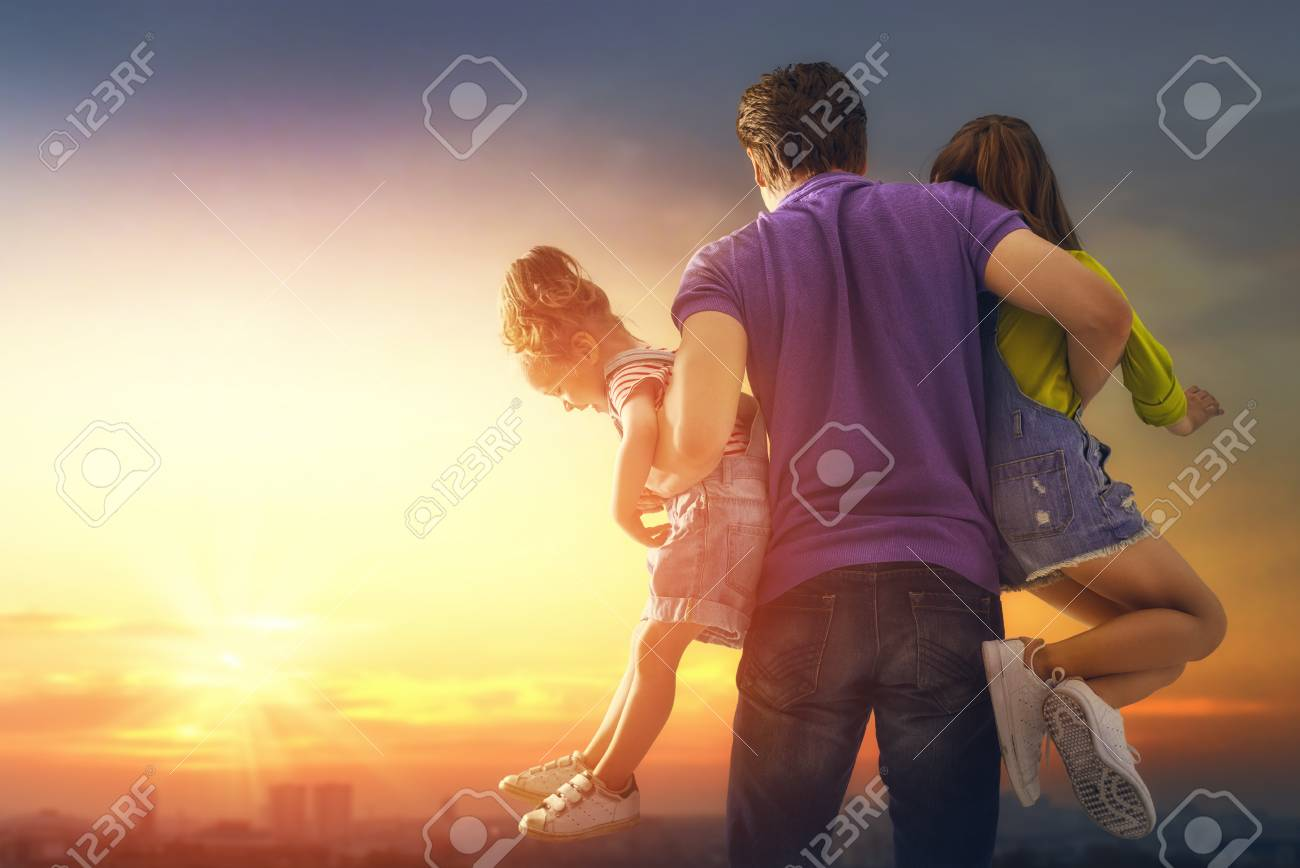 Happy loving family. Father and his daughters children playing and hugging outdoors. Cute little girls and daddy. - 100973026