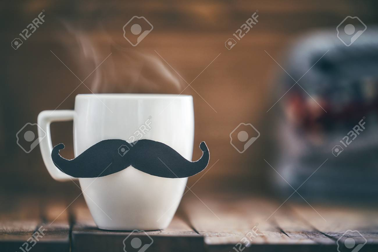 Happy father's day! Cup of coffee on background of wooden table. - 102074402