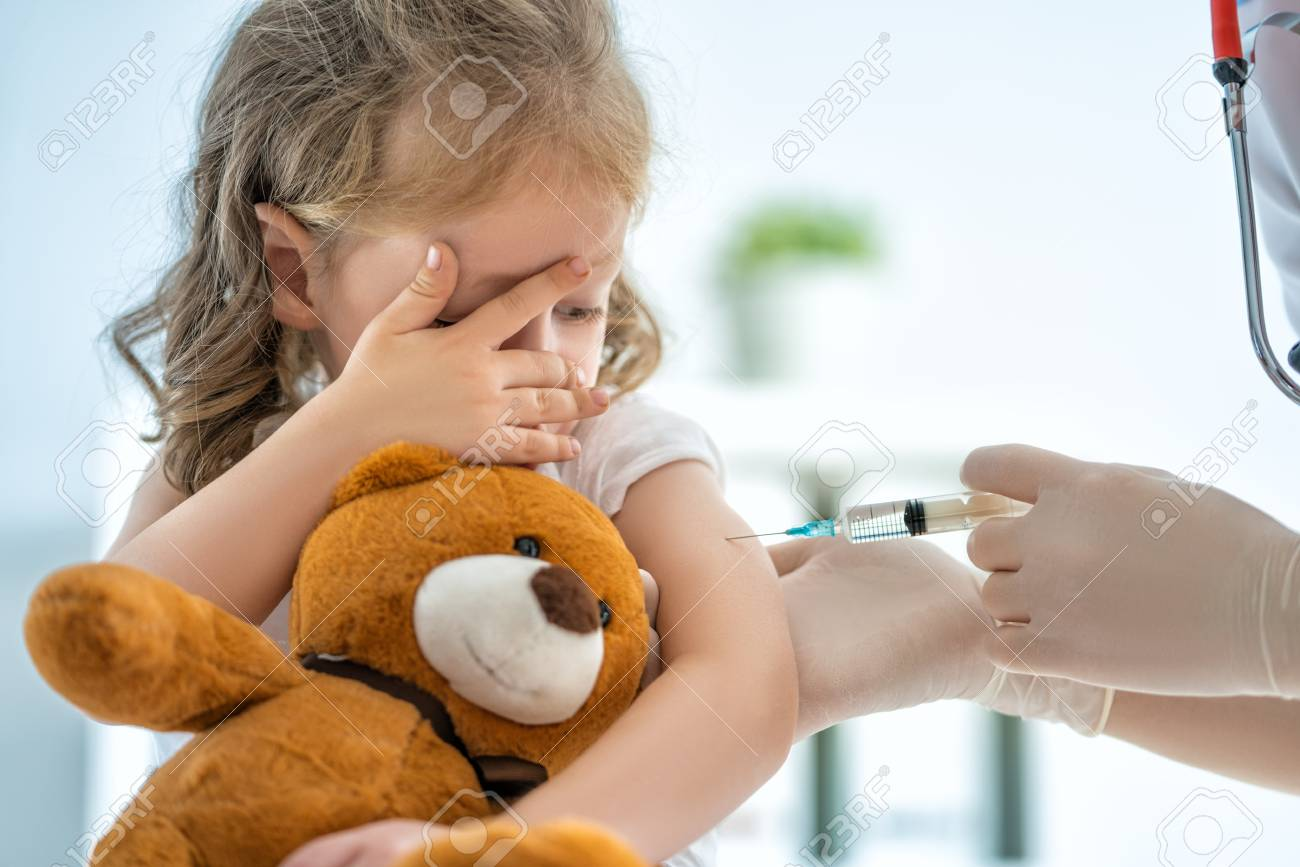 A doctor making a vaccination to a child - 110753931