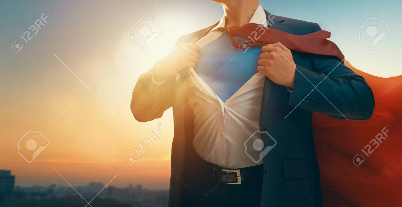 superhero businessman looking at city skyline at sunset. the concept of success, leadership and victory in business. - 115781298