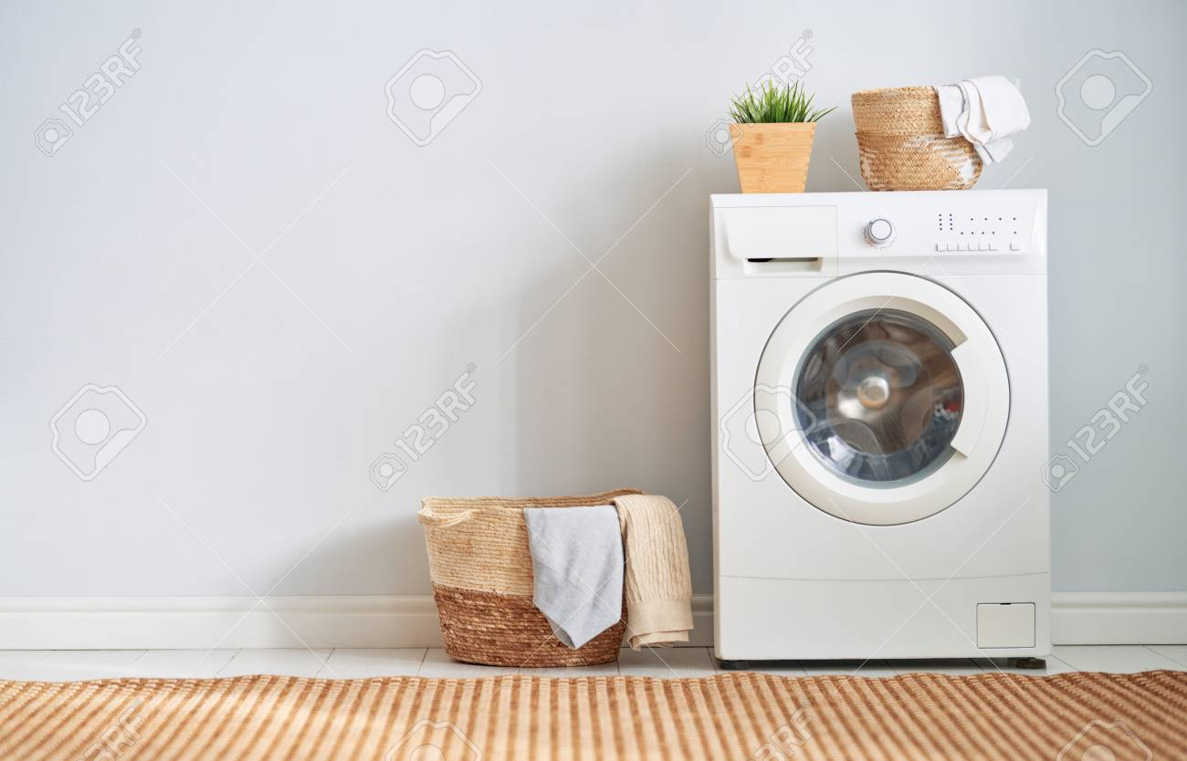 Interior of a real laundry room with a washing machine at home - 118648120