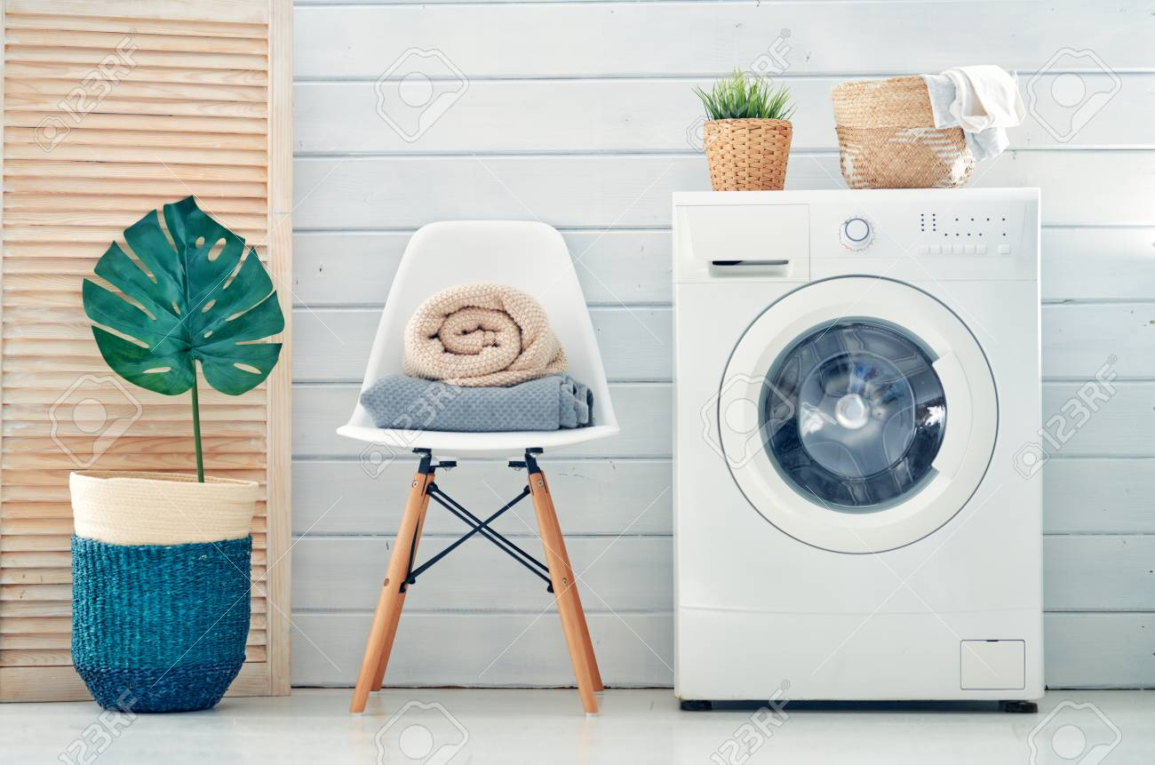 Interior of a real laundry room with a washing machine at home - 118648288
