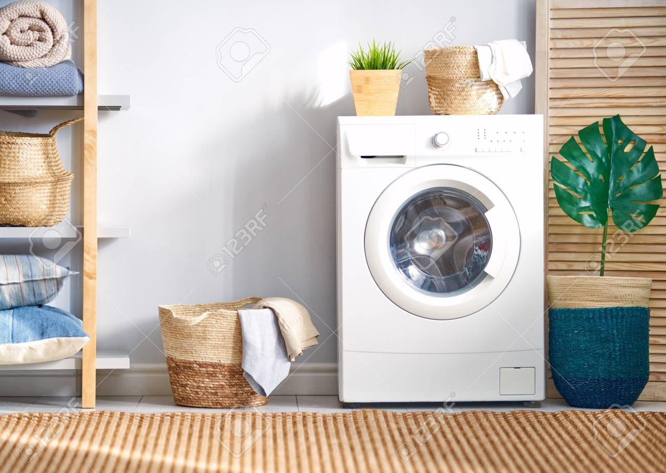 Interior of a real laundry room with a washing machine at home - 119476780
