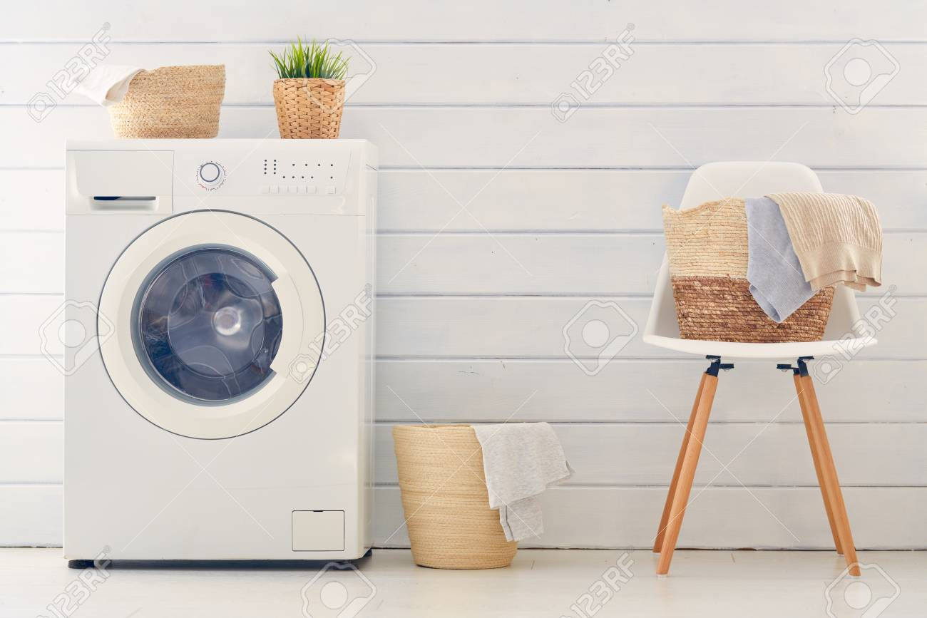 Interior of a real laundry room with a washing machine at home - 119476878