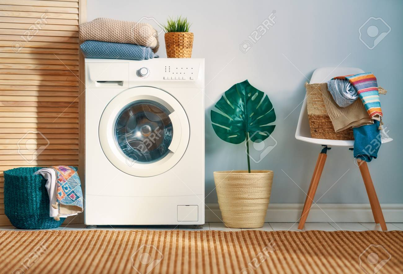 Interior of a real laundry room with a washing machine at home - 119476926