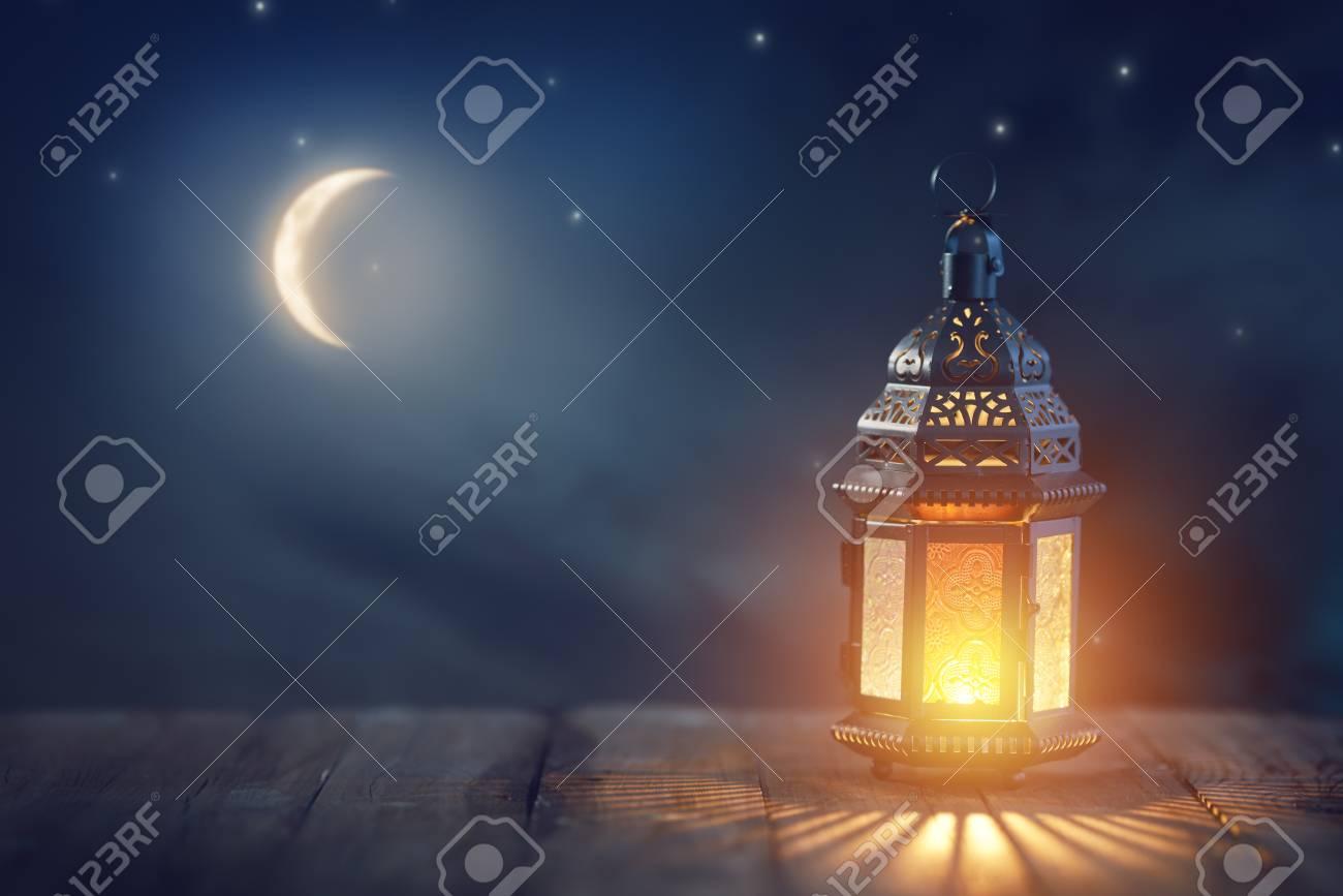 Ornamental Arabic lantern with burning candle glowing at night. Festive greeting card, invitation for Muslim holy month Ramadan Kareem. - 120082238