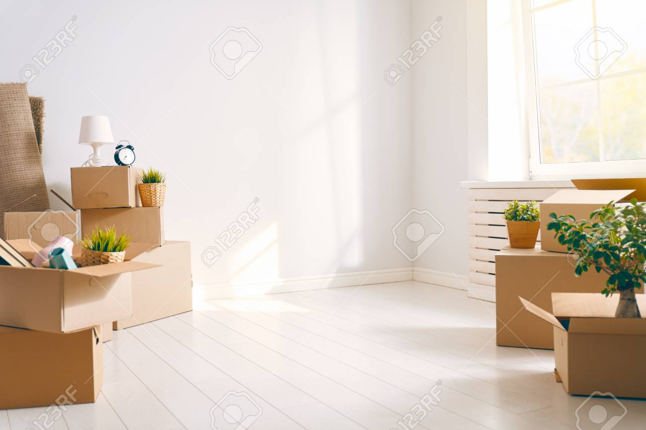 Cardboard boxes in empty new apartment. - 120575149