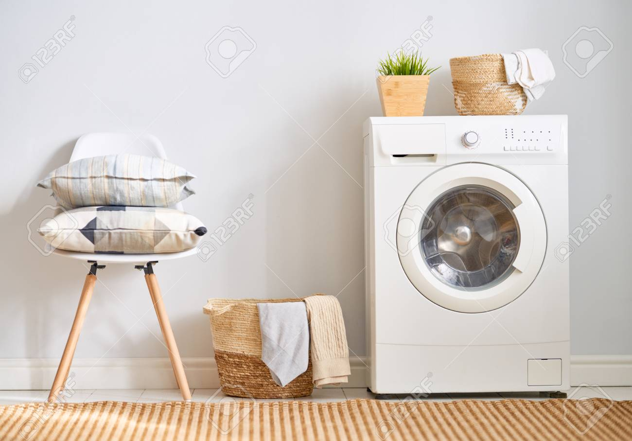 Interior of a real laundry room with a washing machine at home - 120575283