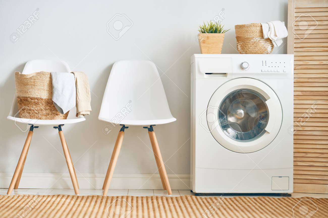 Interior of a real laundry room with a washing machine at home - 121270037