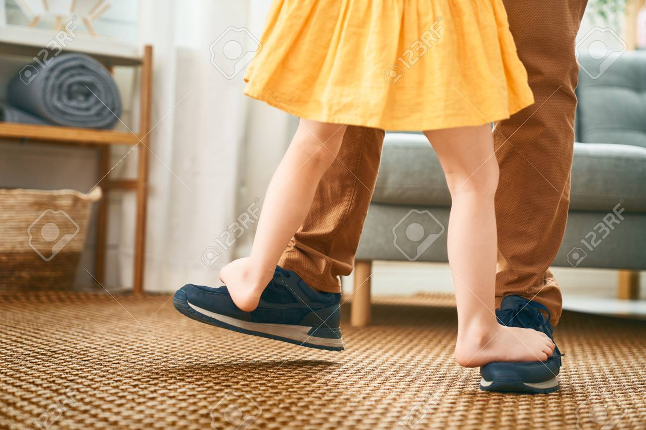 Happy father's day! Dad and his daughter child girl are dancing. Family holiday and togetherness. - 123392435