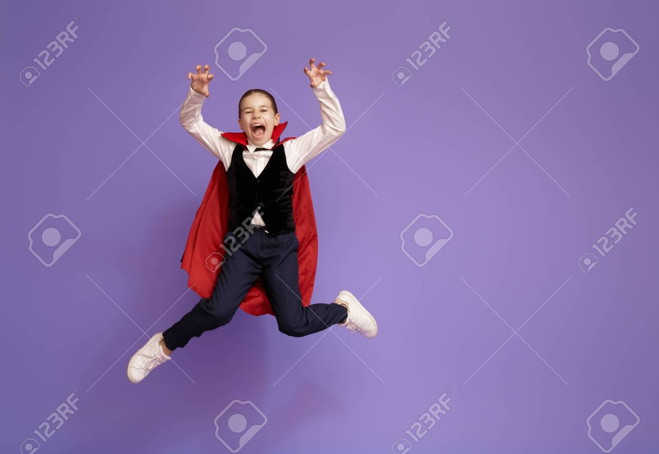 Happy Halloween! Cute little Dracula on purple - 129603401