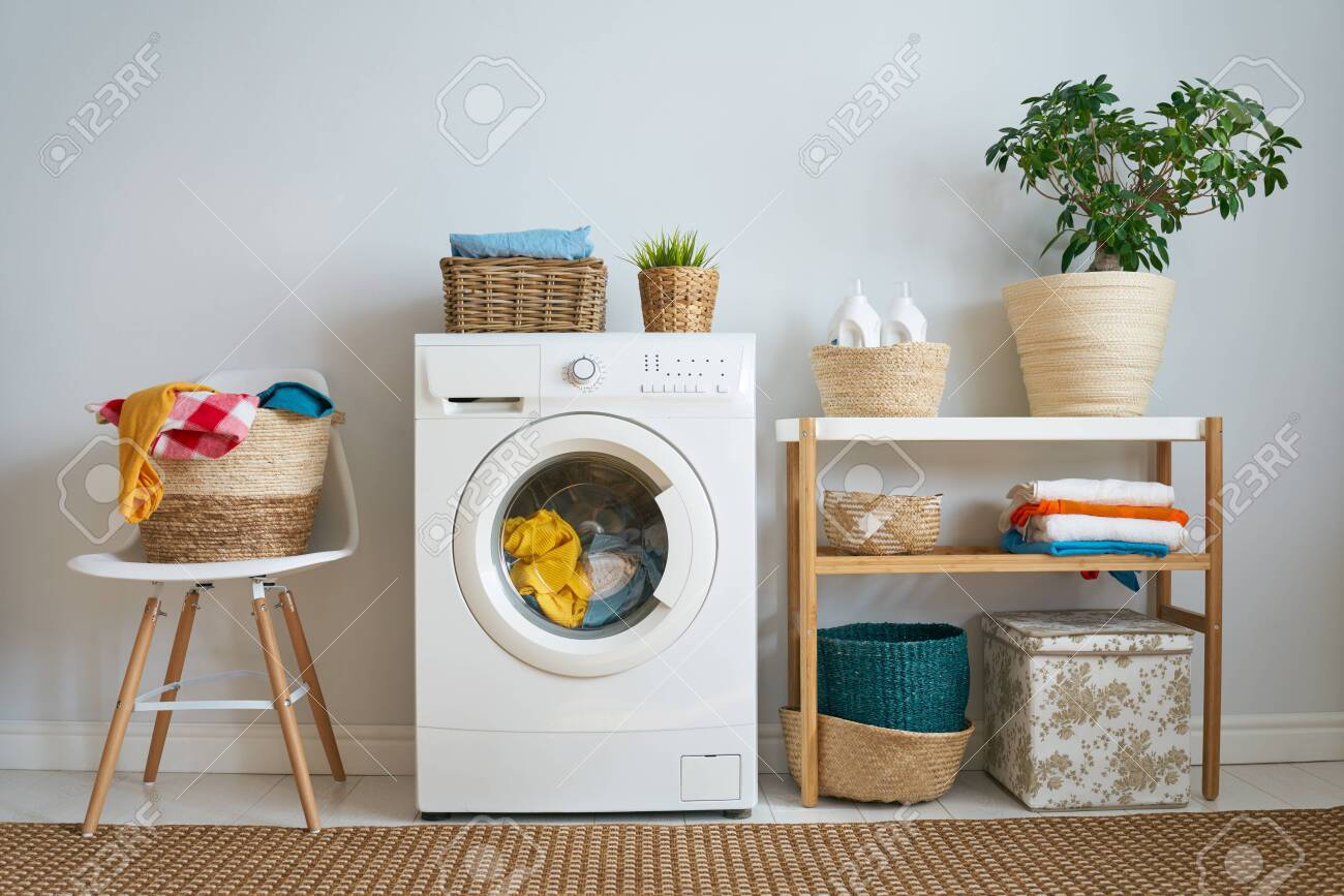 Interior of a real laundry room with a washing machine at home - 131283490