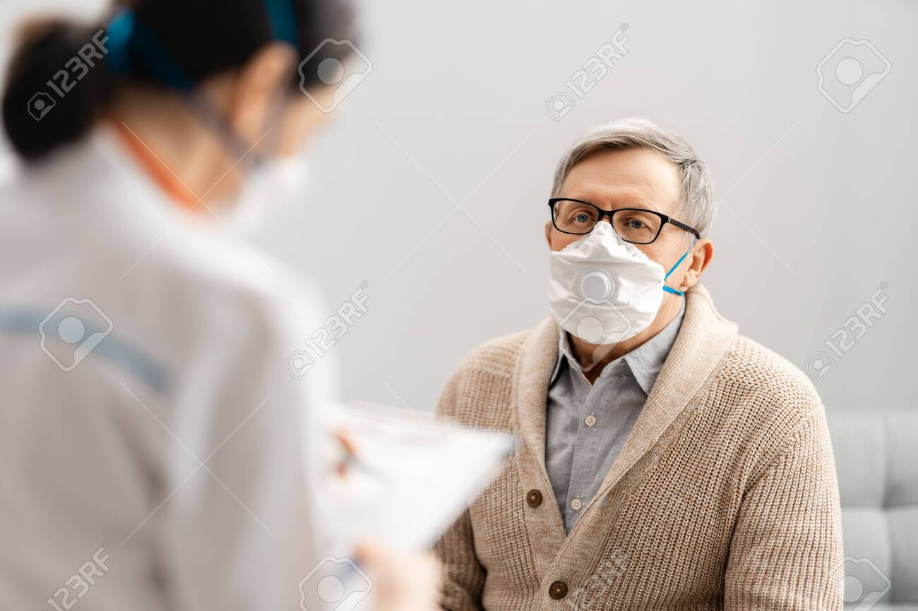 Doctor and senior man wearing facemasks during coronavirus and flu outbreak. Virus and illness protection, home quarantine. COVID-2019 - 143979047