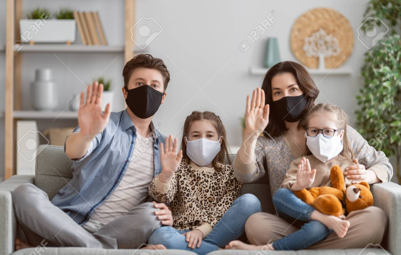 Family is wearing facemasks during coronavirus and flu outbreak. Virus and illness protection, quarantine. COVID-2019. A call to stay at home - 145260761