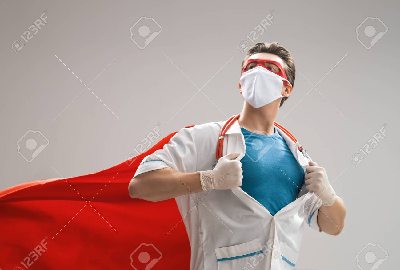 Doctor wearing facemask and superhero cape during coronavirus outbreak. Virus and illness protection, quarantine. COVID-2019. Super hero power for medicine. - 145260772