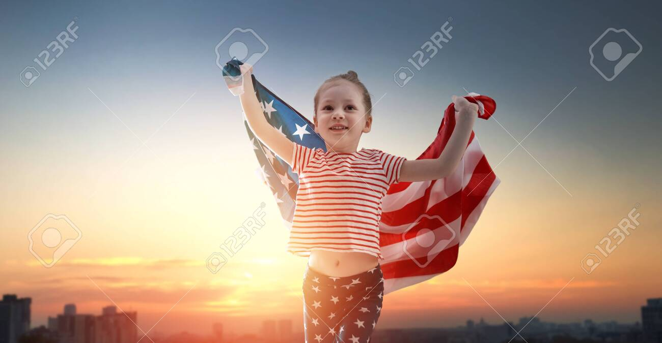 Patriotic holiday. Happy kid, cute little child girl with American flag. USA celebrate 4th of July. - 149343309