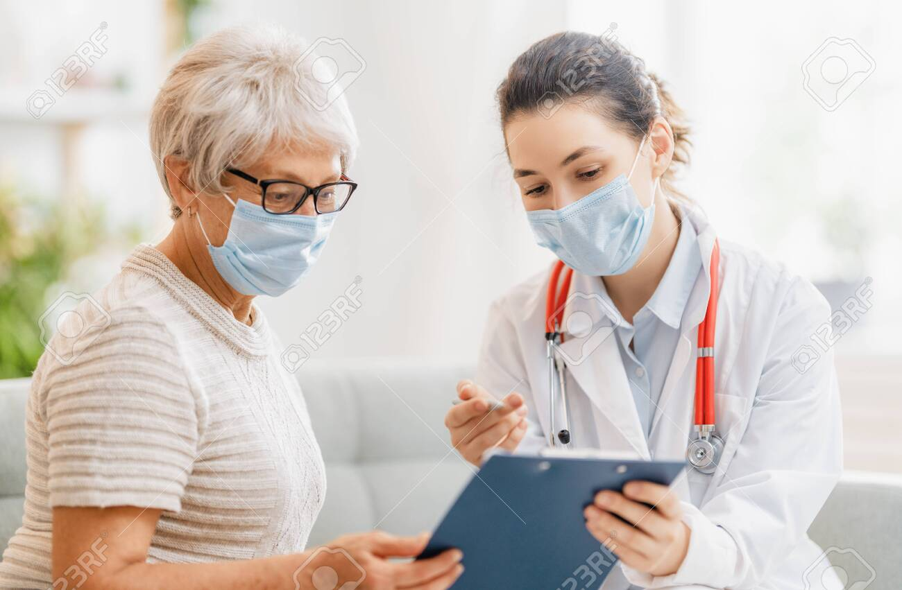 Doctor and senior woman wearing facemasks during coronavirus and flu outbreak. Virus protection. COVID-2019. Taking on masks. - 156610593