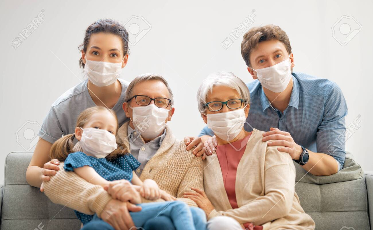 Family is wearing facemasks during coronavirus and flu outbreak. Virus and illness protection, quarantine. COVID-2019. A call to stay at home - 156876543