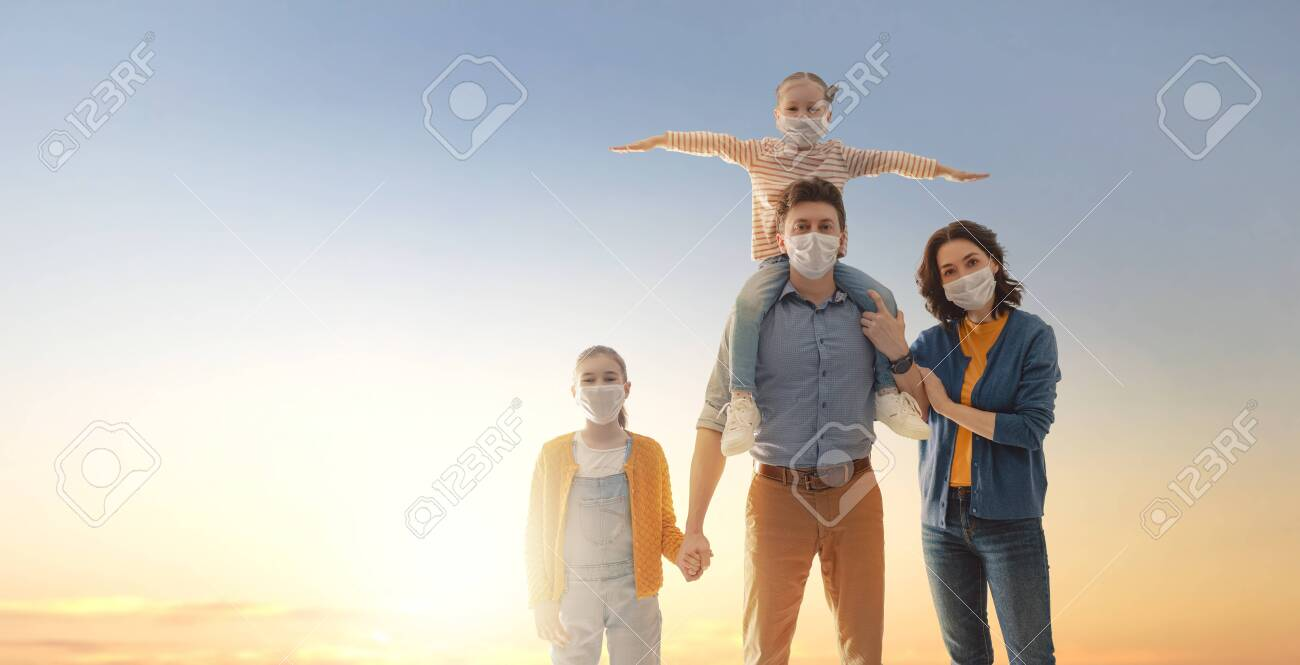 Family is wearing facemasks during coronavirus and flu outbreak. Virus and illness protection, quarantine. COVID-2019. Take on or take off masks. - 156876546