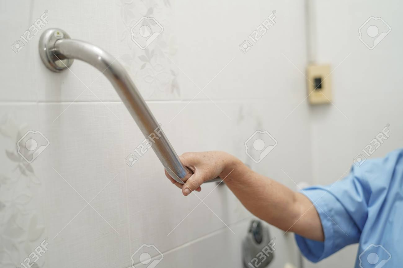 Asian senior or elderly old lady woman patient use toilet bathroom handle security in nursing hospital ward : healthy strong medical concept. - 122825120