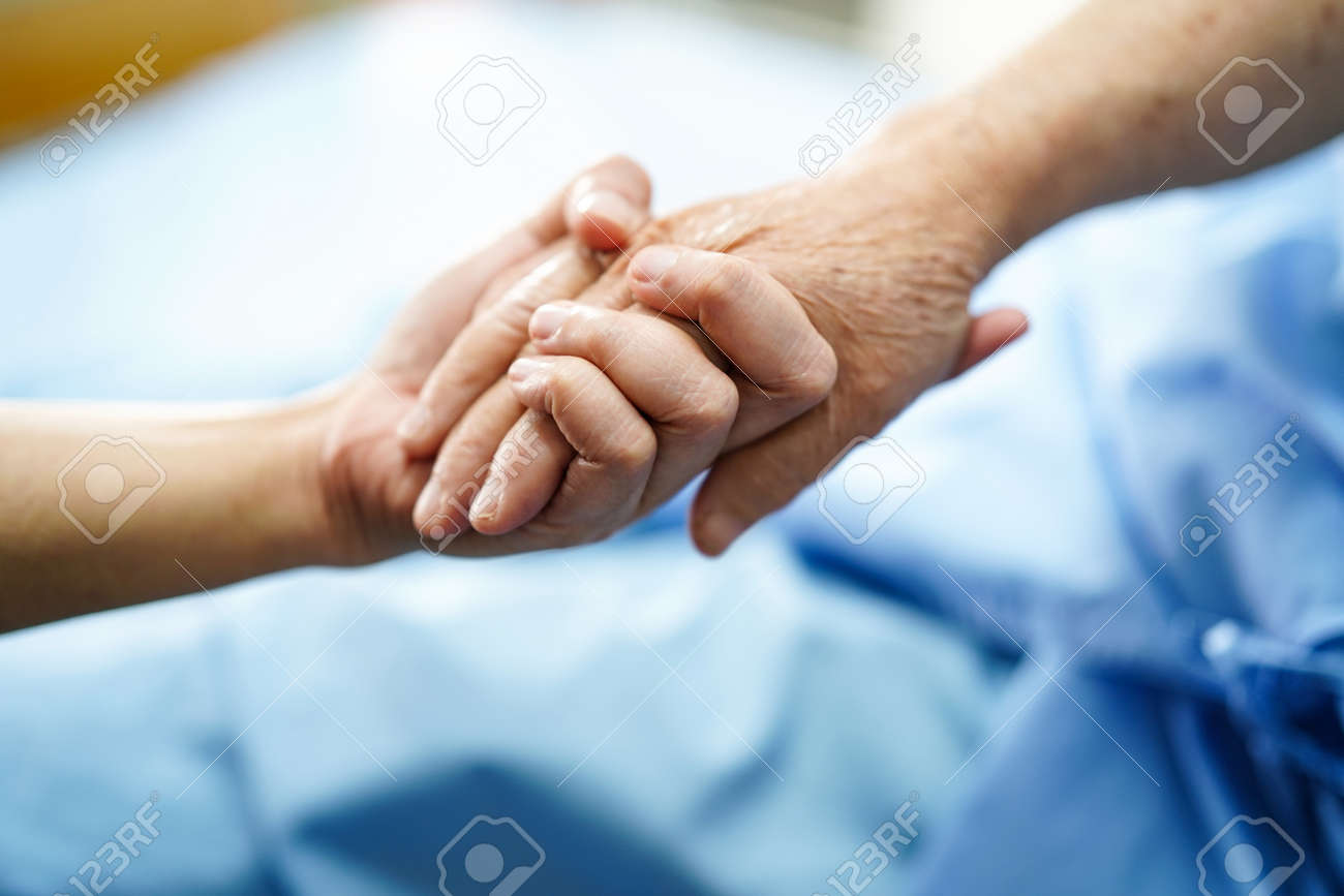 Holding Touching hands Asian senior or elderly old lady woman patient with love, care, helping, encourage and empathy at nursing hospital ward : healthy strong medical concept - 130724933