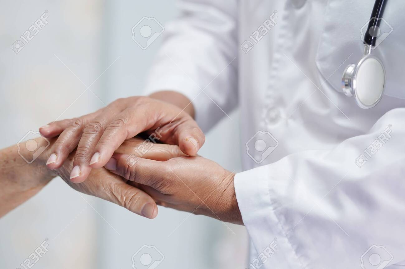 Holding Touching hands Asian senior or elderly old lady woman patient with love, care, helping, encourage and empathy at nursing hospital ward : healthy strong medical concept - 139224769