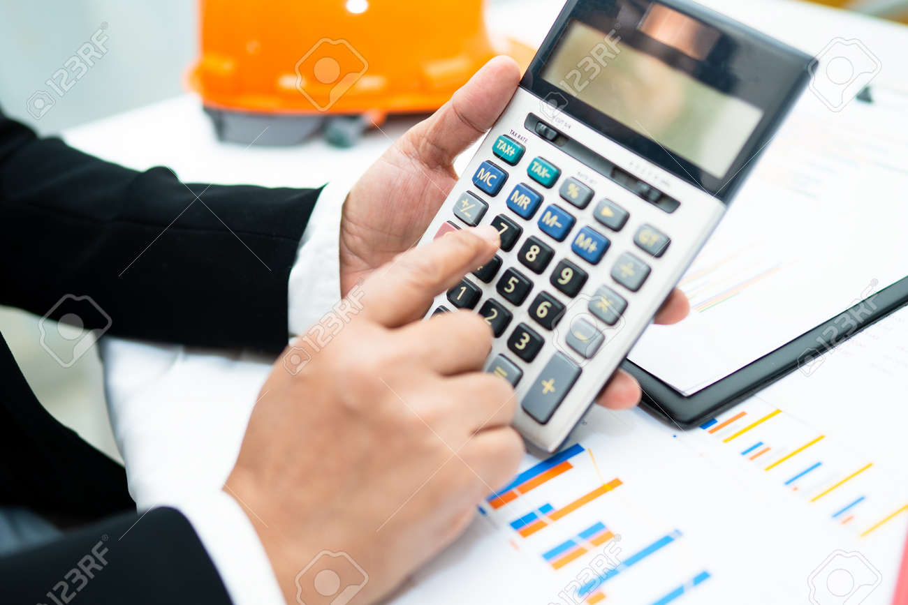 Asian accountant working and analyzing financial reports project accounting with chart graph and calculator in modern office,finance and business concept. - 151117617