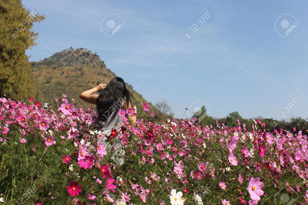 Girl Running Through Across A Field Of Flowers Stock Photo Picture