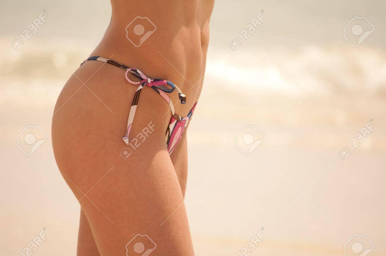 Nice bikini body wearing lycra thong swimwear bottom Stock Photo - 5396004