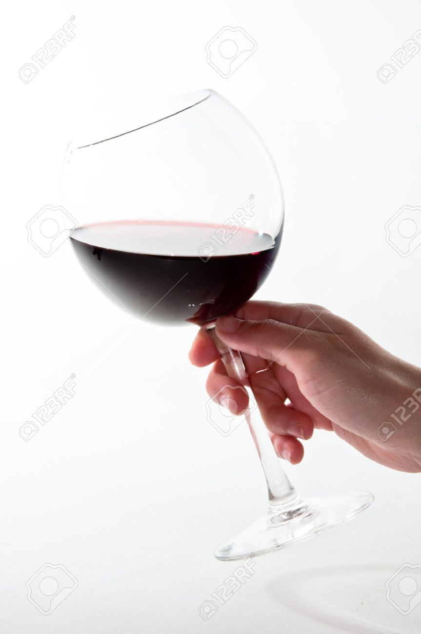 Female hand holding red wine glass over white background Stock Photo - 7823729
