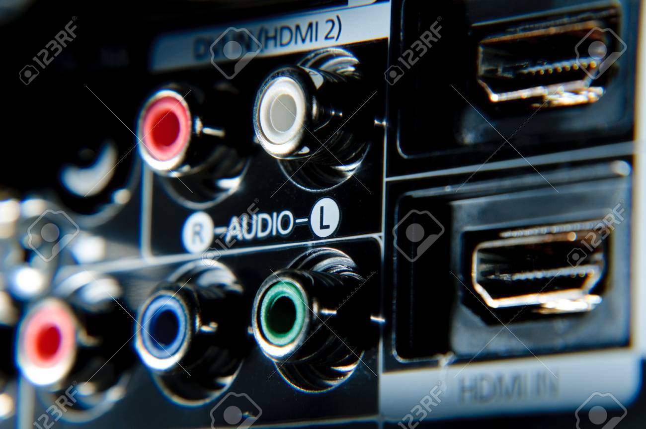 Red, white, green and blue rca connections behind high definition tv. Stock Photo - 7823738