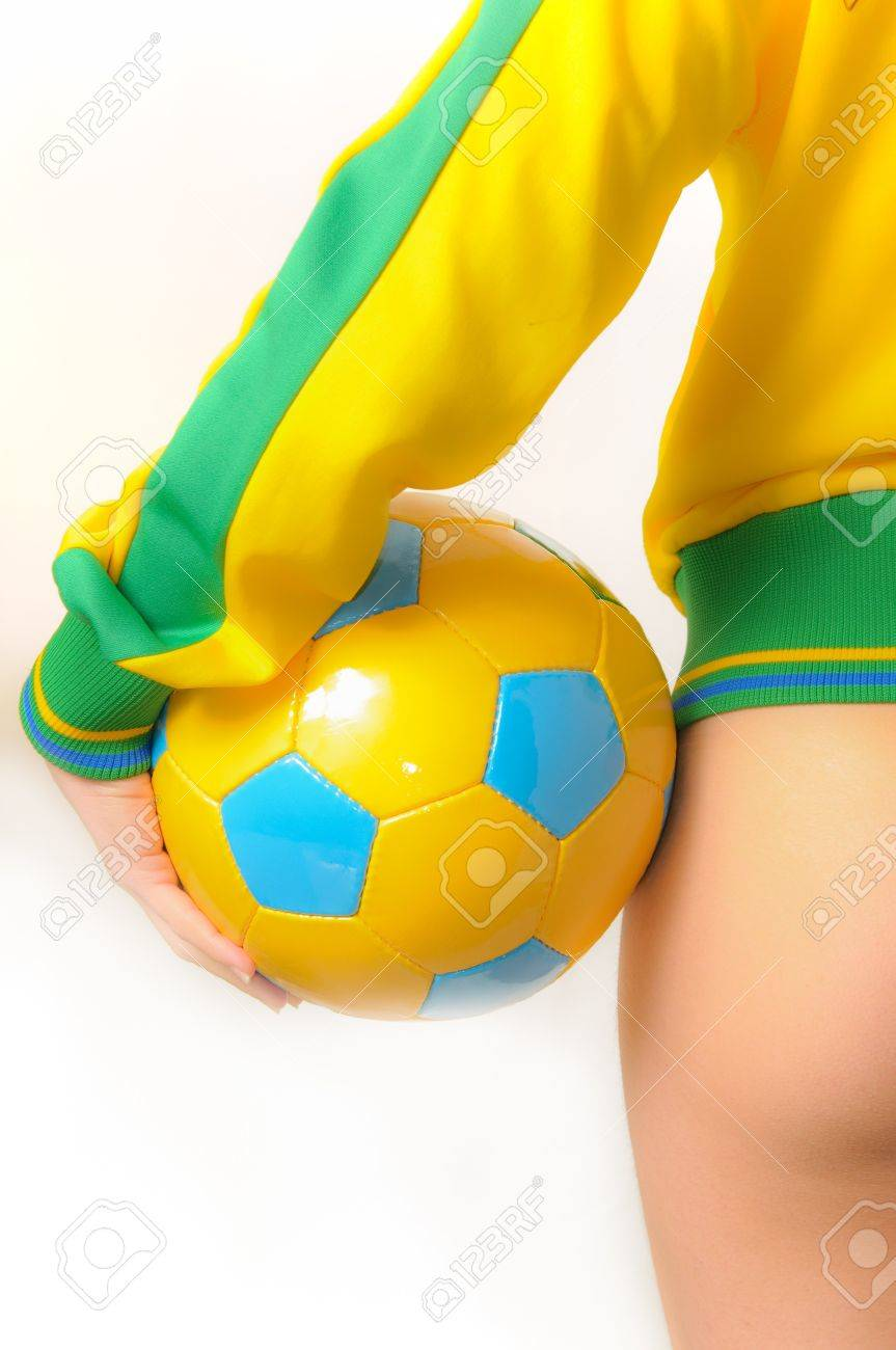 Beautiful Brazilian model wearing a green and yellow soccer thong bikini bottom  holding a soccer ball isolated over white background Stock Photo - 8264850