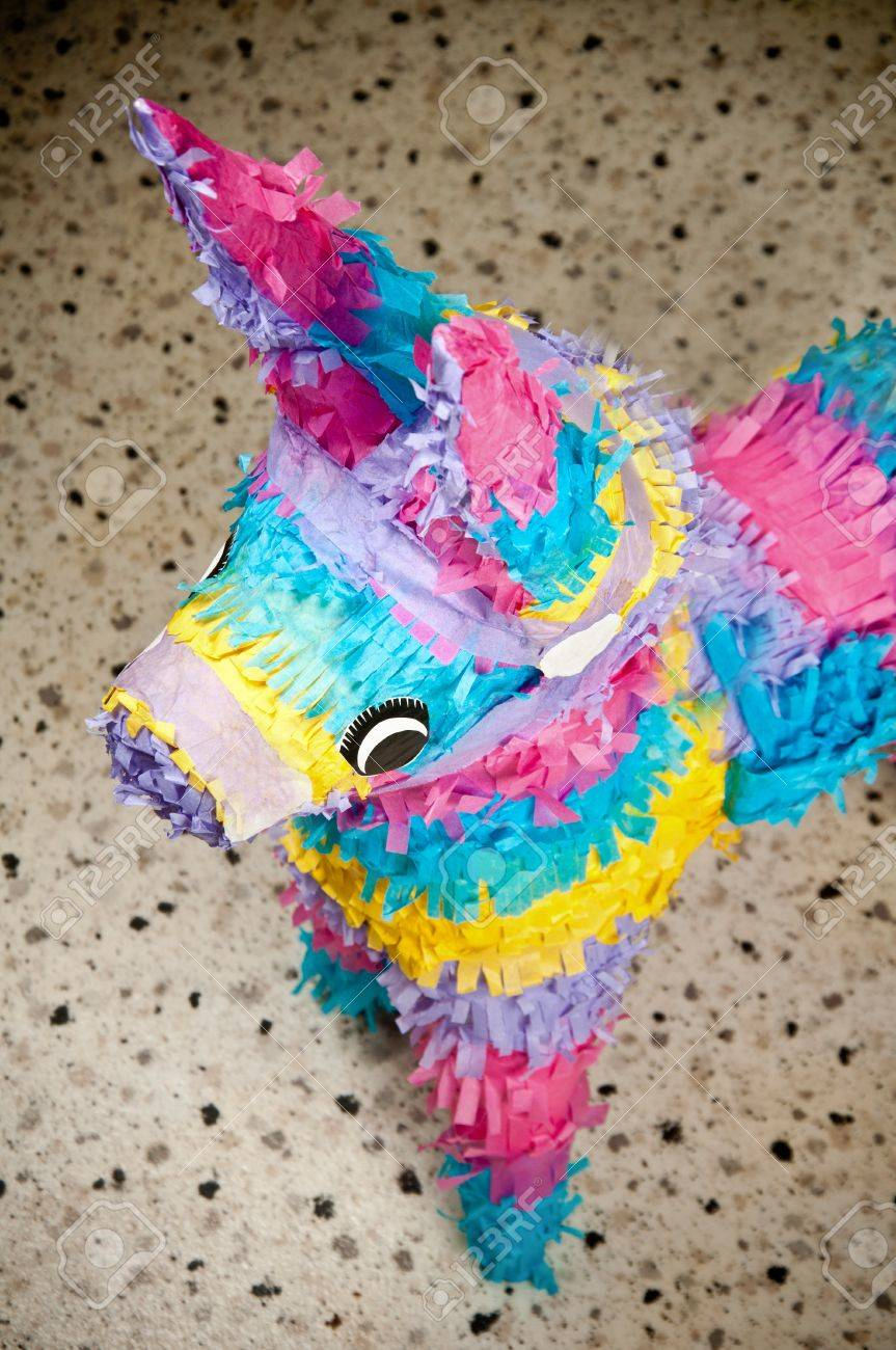 colorful donkey pinata over blurred backgound stock photo picture