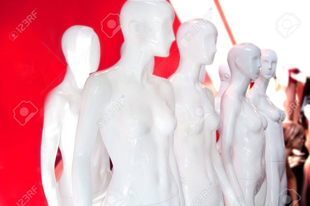Eight white store fashion female mannequins displayed grouped together Stock Photo - 11716192
