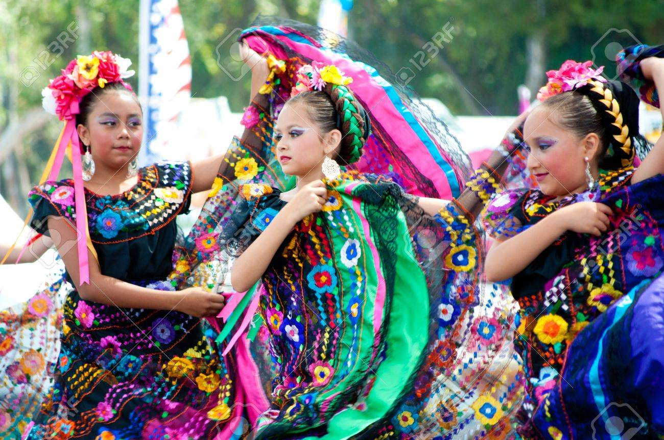 COSTA MESA, CA - JULY 24: Unidentified Mexican dancers perform in traditional costumes on stage at the Orange County State Fair in Costa Mesa, CA on July 24th 2010. Stock Photo - 14143576