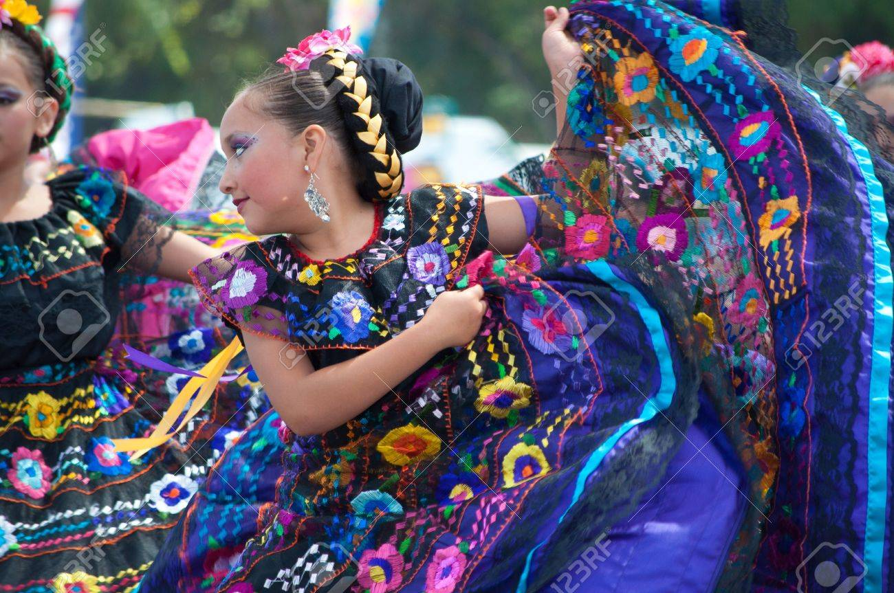 COSTA MESA, CA - JULY 24: Unidentified Mexican dancers perform in traditional costumes on stage at the Orange County State Fair in Costa Mesa, CA on July 24th 2010. Stock Photo - 14174727