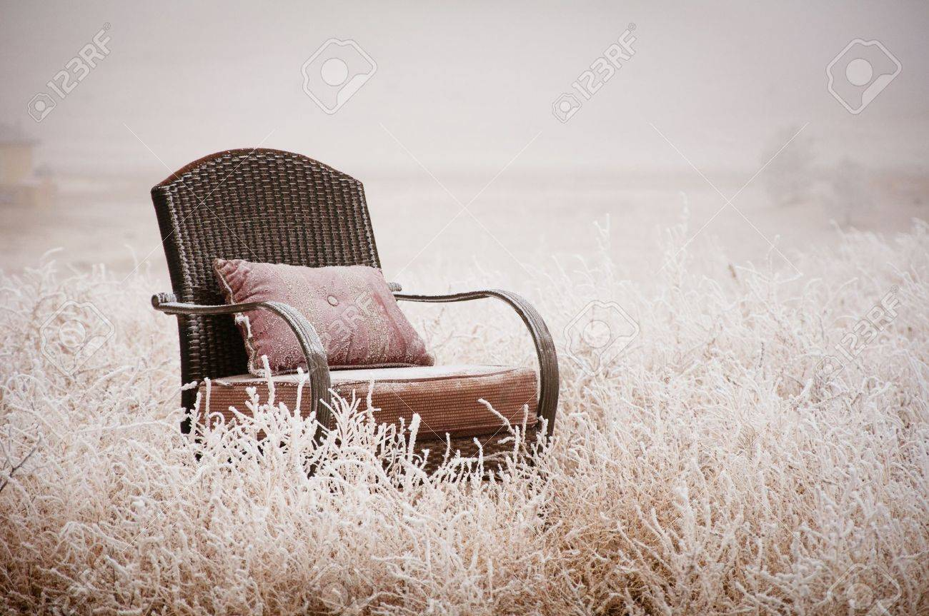 Vintage chair ona morning frost after a night of snow Stock Photo - 14399067