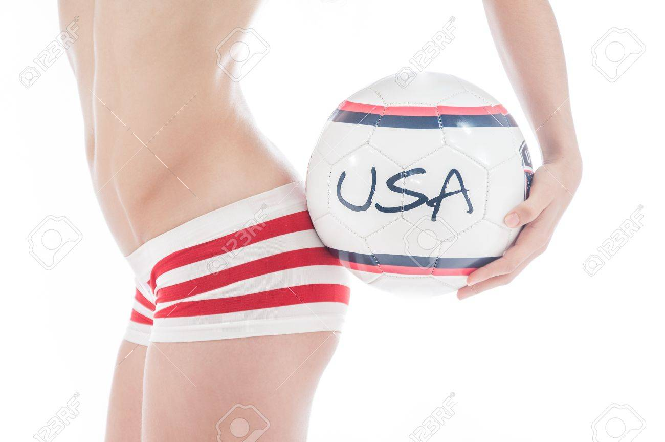 Beautiful model wearing blue,  red and white underwear holding a USA team ball isolated on white representing a football or soccer cheerleader Stock Photo - 15606509
