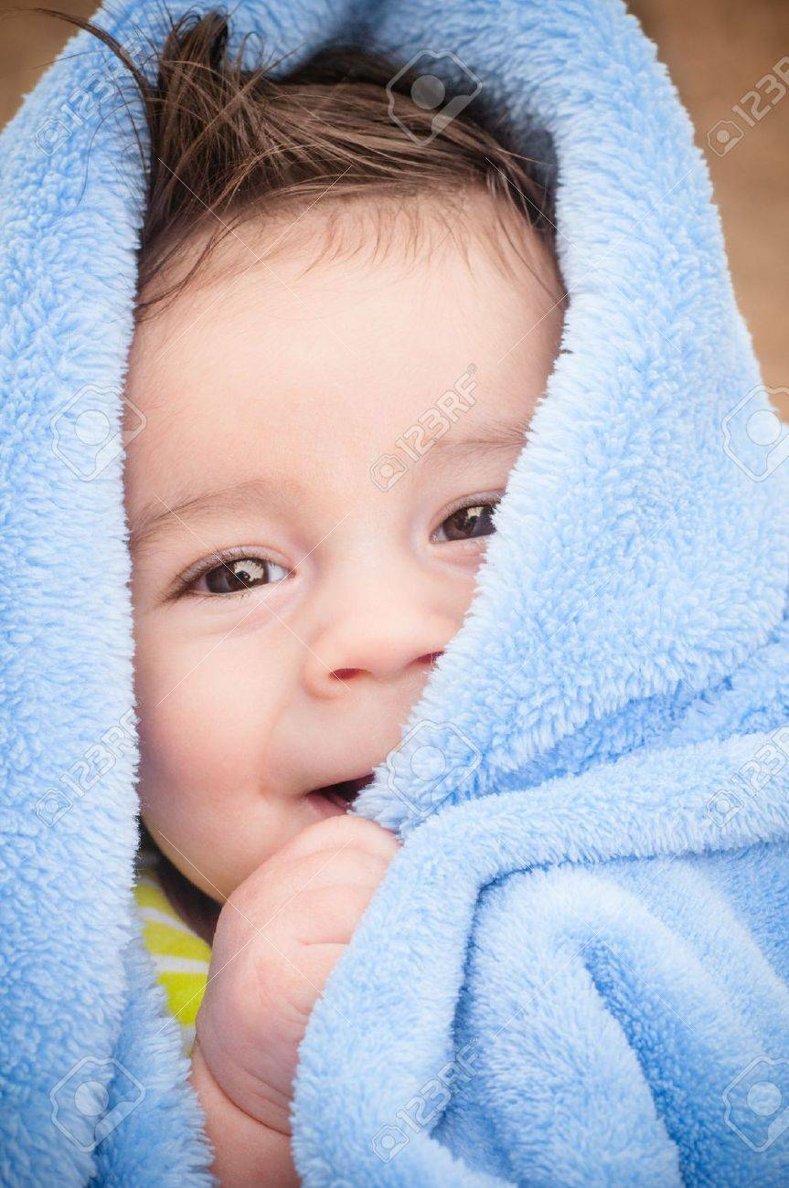 Baby boy under light blue blanket after a bath Stock Photo - 16901641