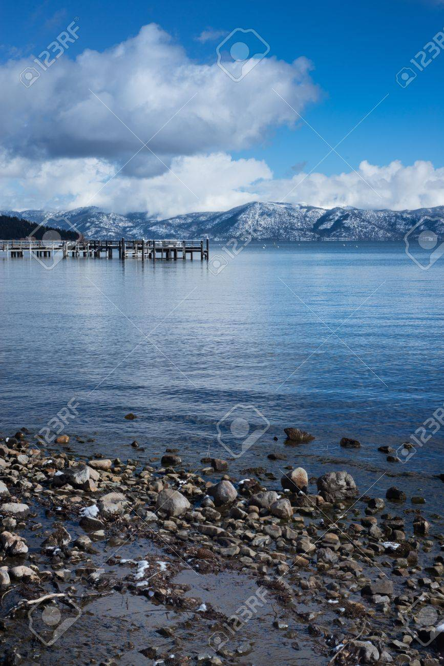 Rocky shore and mountain background at blue lake Stock Photo - 17831168