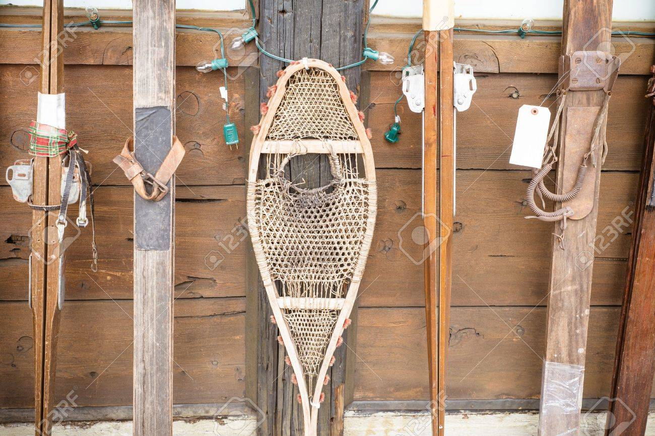 Snow Shoes and vintage skiis  on display at winter resort Stock Photo - 18251633